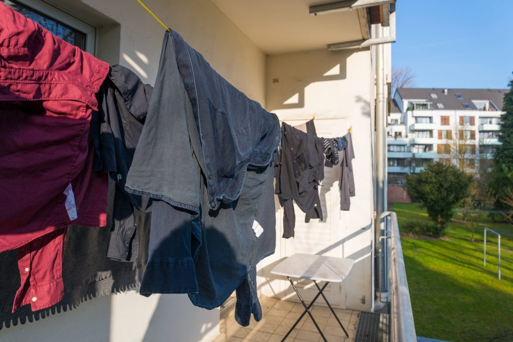 Clothes dry by hanging on clothes line at the balcony